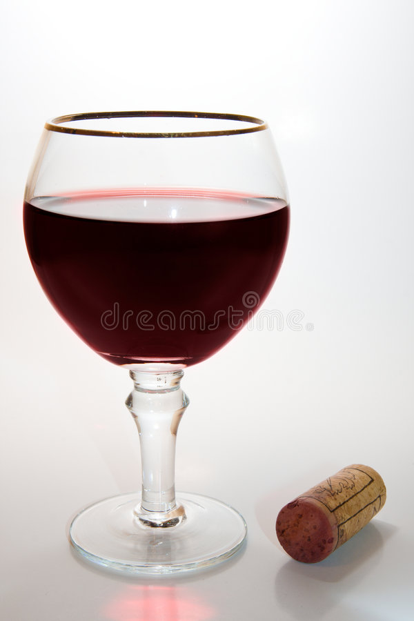 Glass of wine and cork stock photos