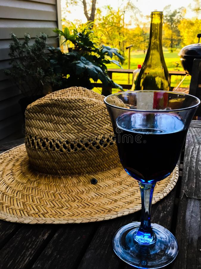 Glass of wine on farm. Farming and stopping to enjoy a glass of wine in east Texas,wine hat,wine bottle stock photo