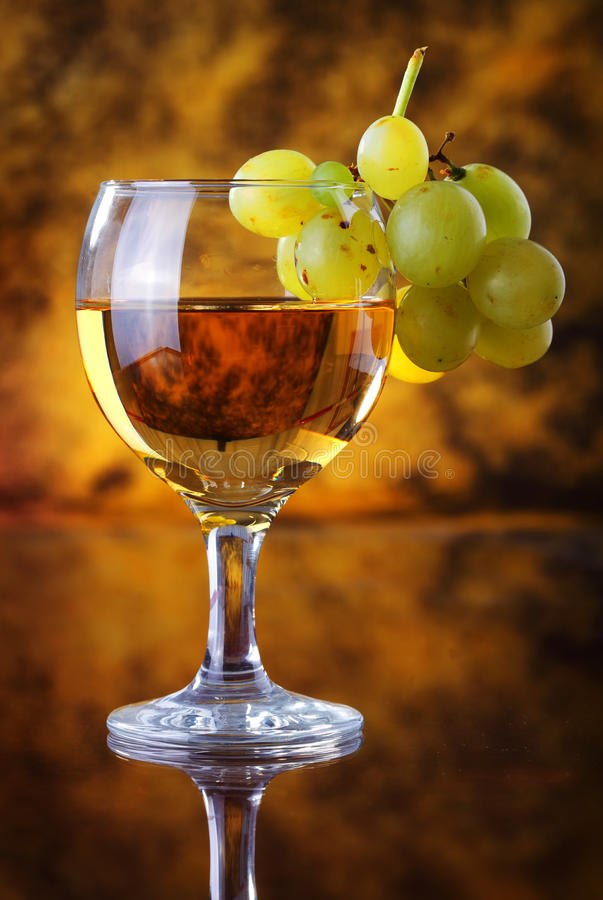 Glass of wine with grape stock photo