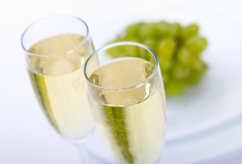 Glass of wine with grape stock photography