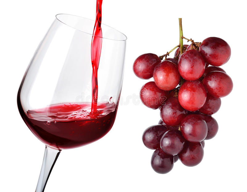 Glass of wine and grapes. Isolated on white royalty free stock photo