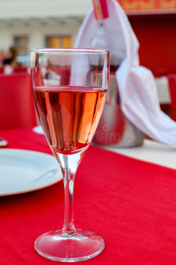 A glass of wine with lip's stain. In restaurant royalty free stock photography