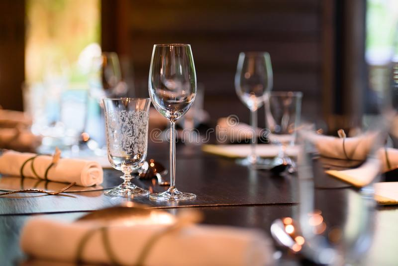 A glass of wine is placed on the dinner table. stock photo