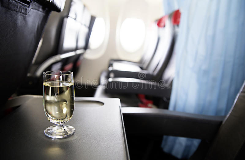 Glass of wine in the plane. Photo of glass of wine in the plane stock photo