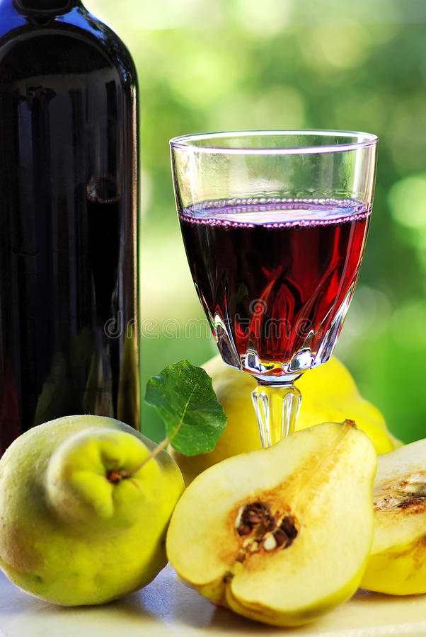 Download Glass Of Wine And Quince Fruits. Stock Photo - Image: 22201764