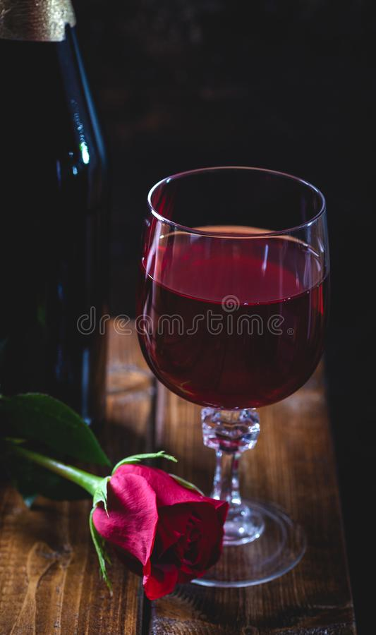 Glass of Wine and Red Rose royalty free stock photos