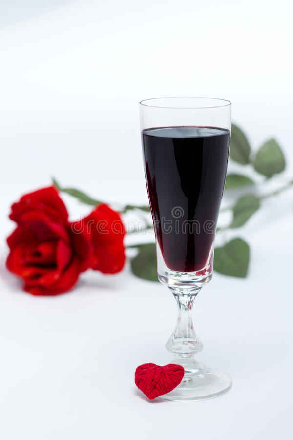 Glass of wine the rose and heart royalty free stock photos