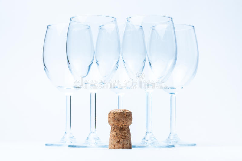 Glass wine stand symmetrically with cork