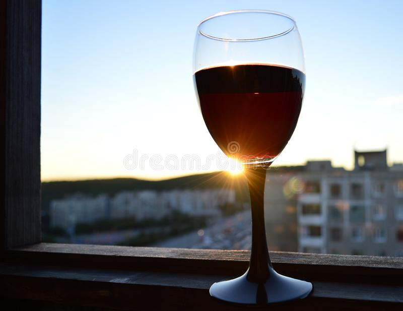 A glass of wine at sunset. royalty free stock photos