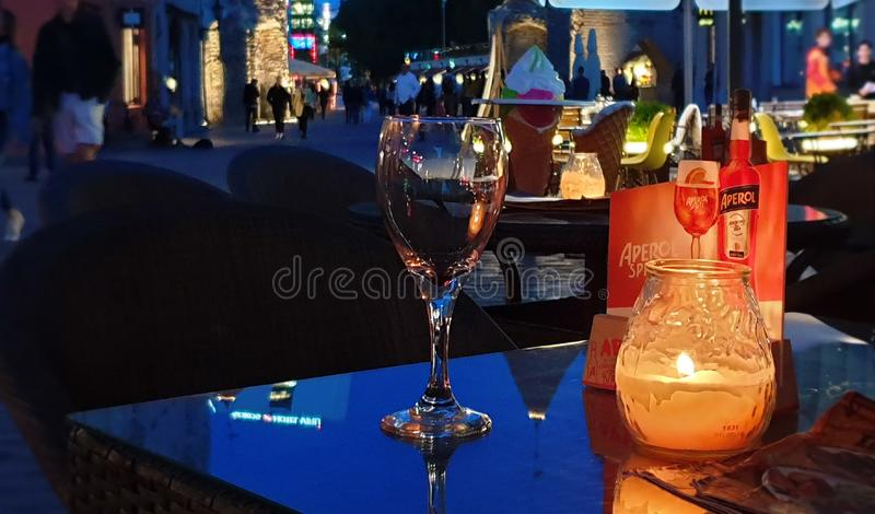 Glass of wine on table old town of Tallinn ,Estonia 20,08,2019 Cup of coffee and glass of wine on table urban city lifestyle. City lifestyle, Street cafe evening stock images