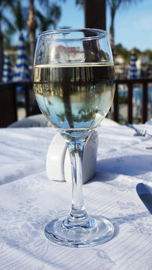 Glass of wine with white wine alcohol is on the table. Drink royalty free stock images
