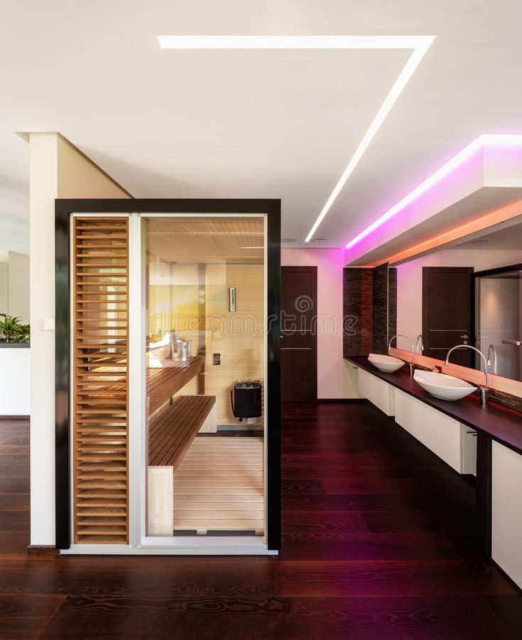 Glass and wood sauna in modern villa royalty free stock images