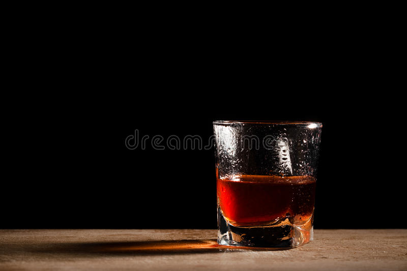Glass on a wooden table stock photo