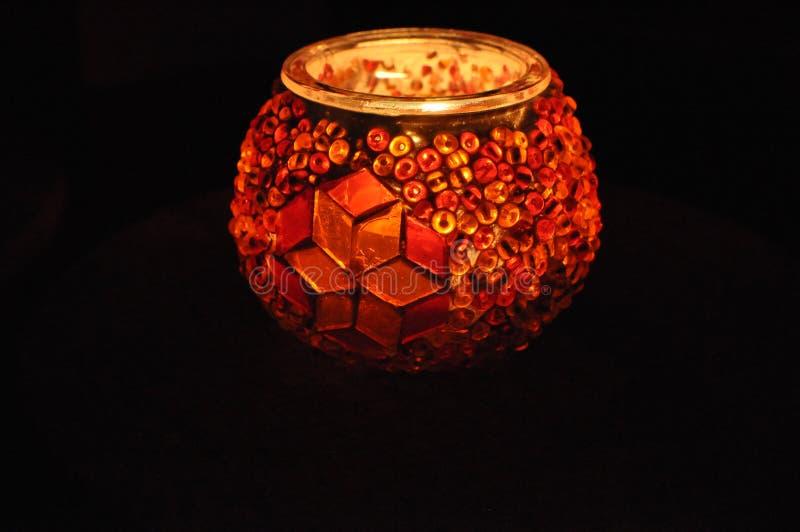 Glass work - amazing candle glow royalty free stock photo