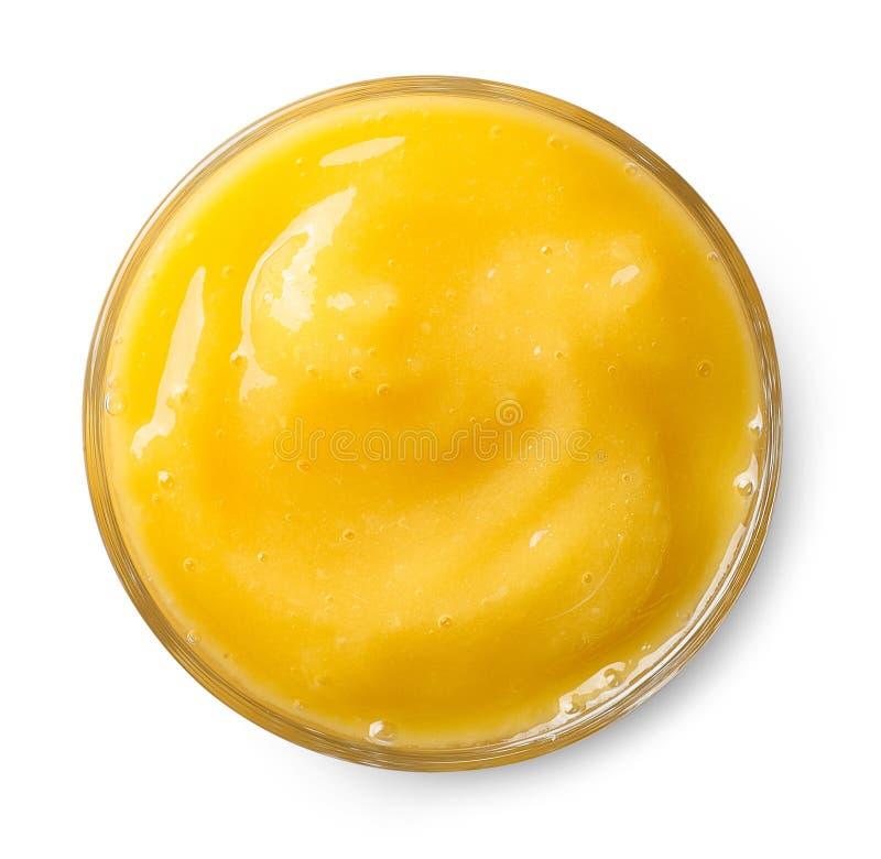 Glass of mango smoothie stock photos