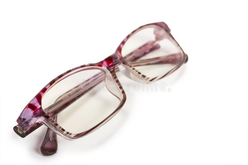 Glasses. Beautiful women's glasses on white background royalty free stock photo