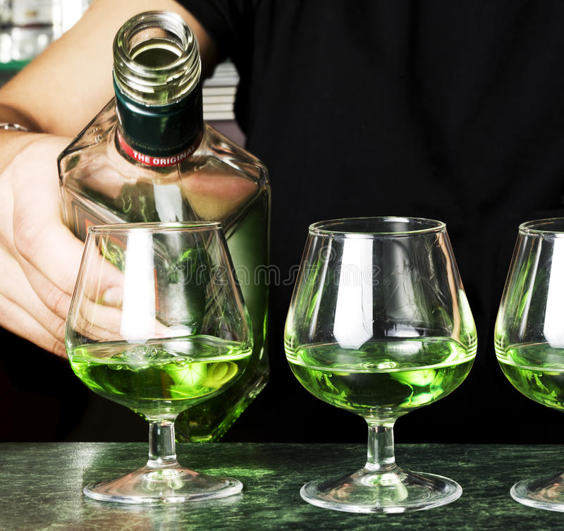 Glasses of absinthe stock images
