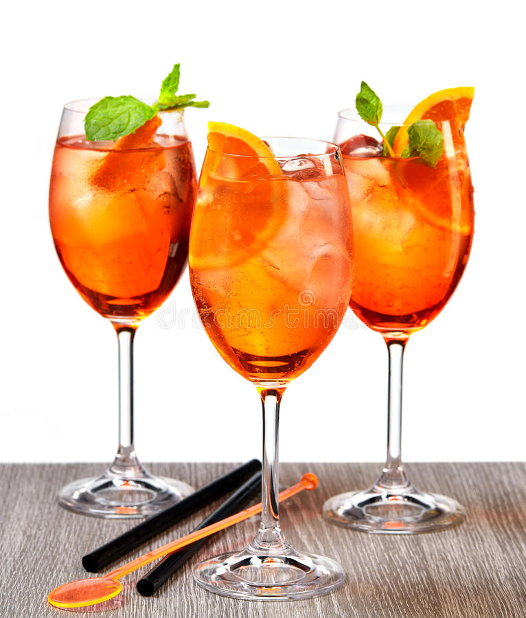 Glasses of aperol spritz cocktail. On grey wooden table isolated on white background royalty free stock images