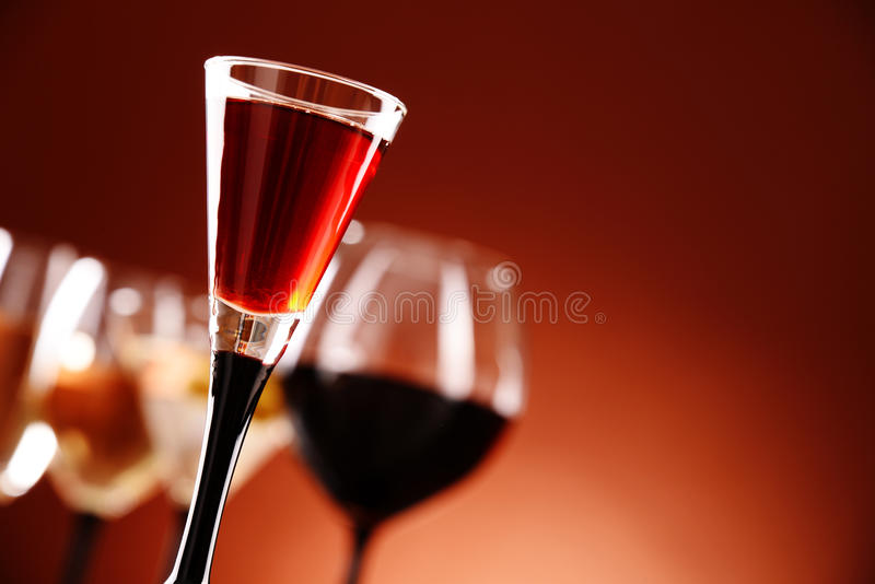 Glasses with assorted alcoholic beverages.  stock image