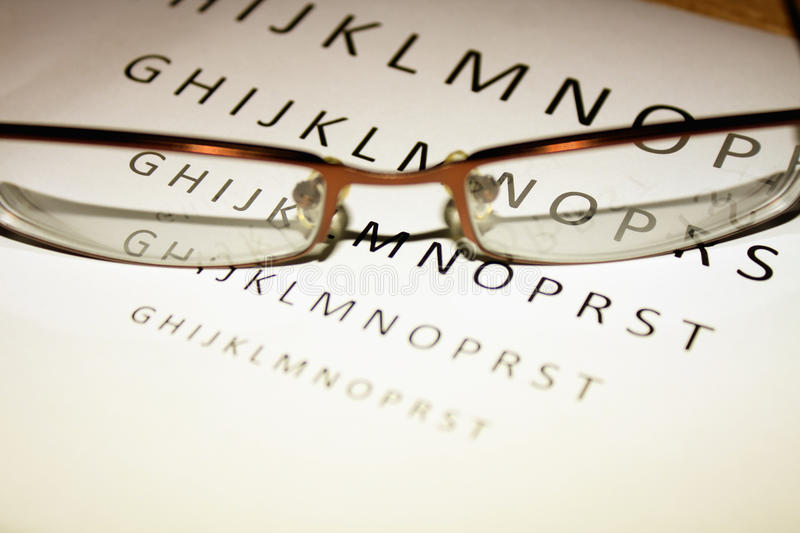 Glasses in the back of eye test royalty free stock photos