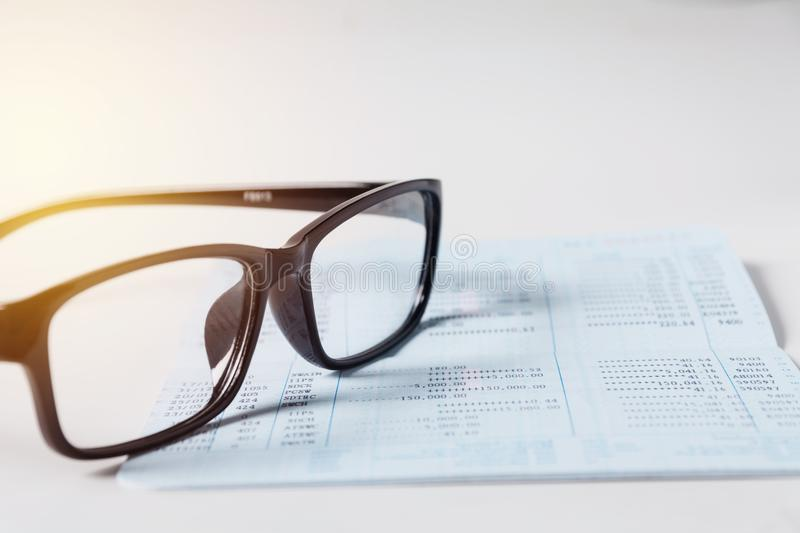 Glasses with bank account passbook for savings financial and accounting concept. stock photo