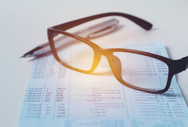Glasses with bank account passbook for savings financial and accounting concept. royalty free stock photography