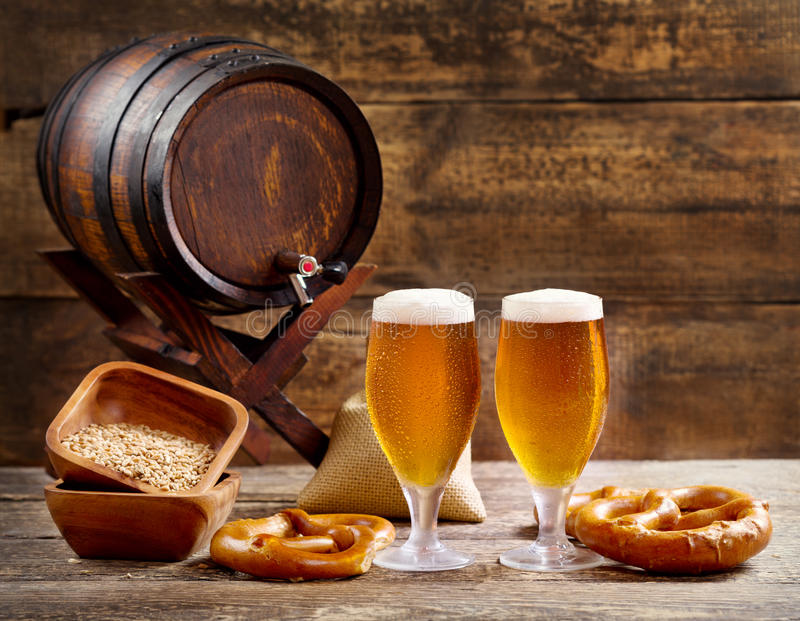 Glasses of beer with barrel royalty free stock photography