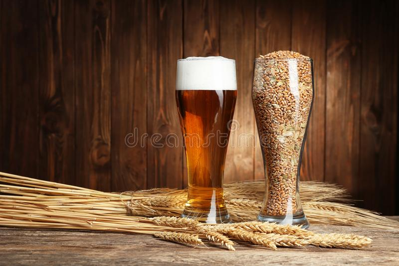 Glasses of beer and seeds with spikes stock images