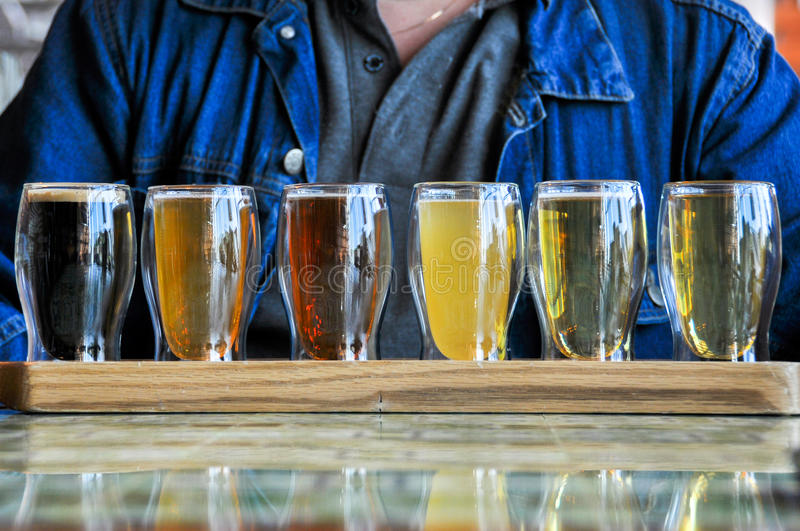 Glasses of Beers. Glasses of the different Beers on wood desk royalty free stock images