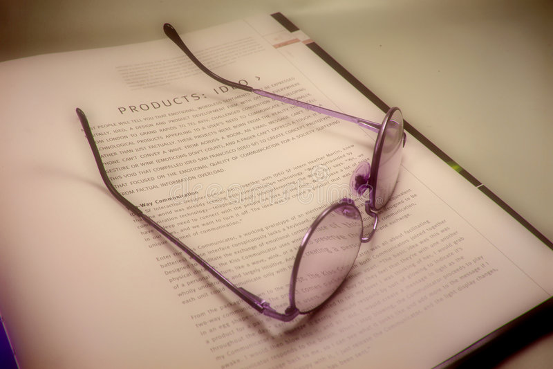 Glasses on a book royalty free stock images