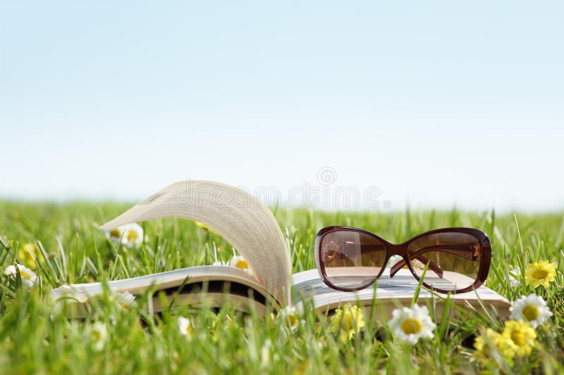 Glasses On A Book Outside Royalty Free Stock Image