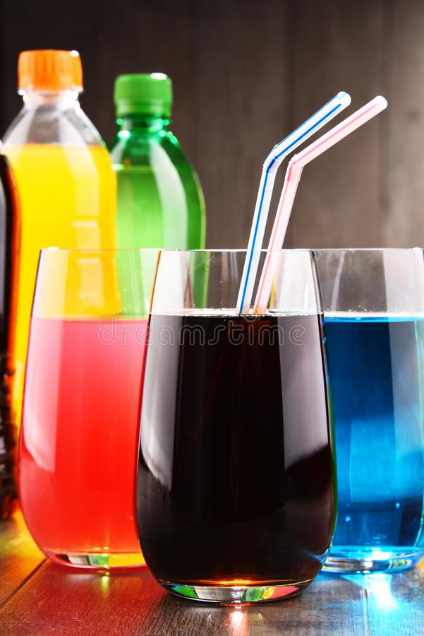 Glasses and bottles of assorted carbonated soft drinks. In variety of colors royalty free stock photos