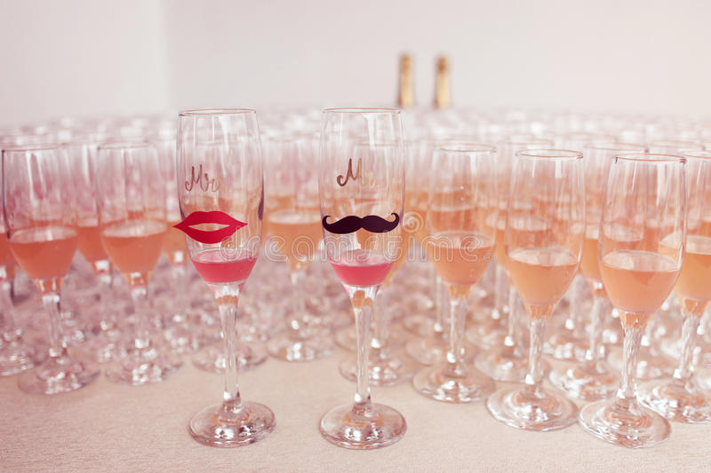 Glasses for bride and groom and guests filled with campagne royalty free stock photos