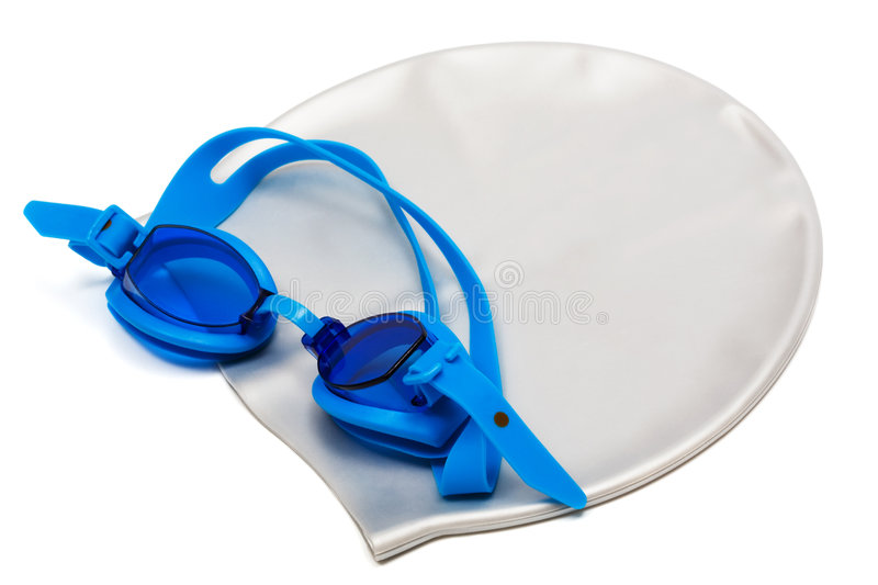 Glasses and cap for swimming. On a white background royalty free stock photography