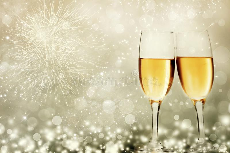 Glasses with champagne against fireworks royalty free stock photography