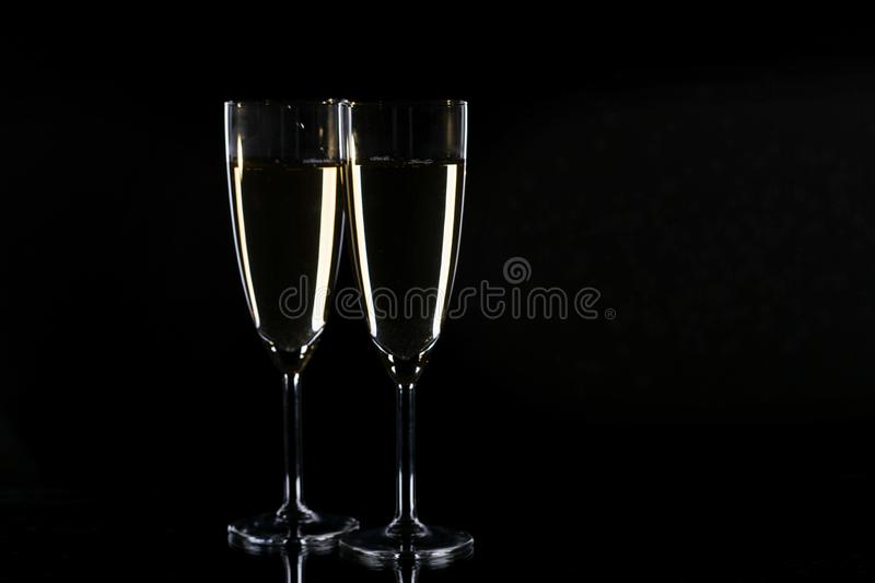 Glasses with champagne. On black background, New Year background stock images