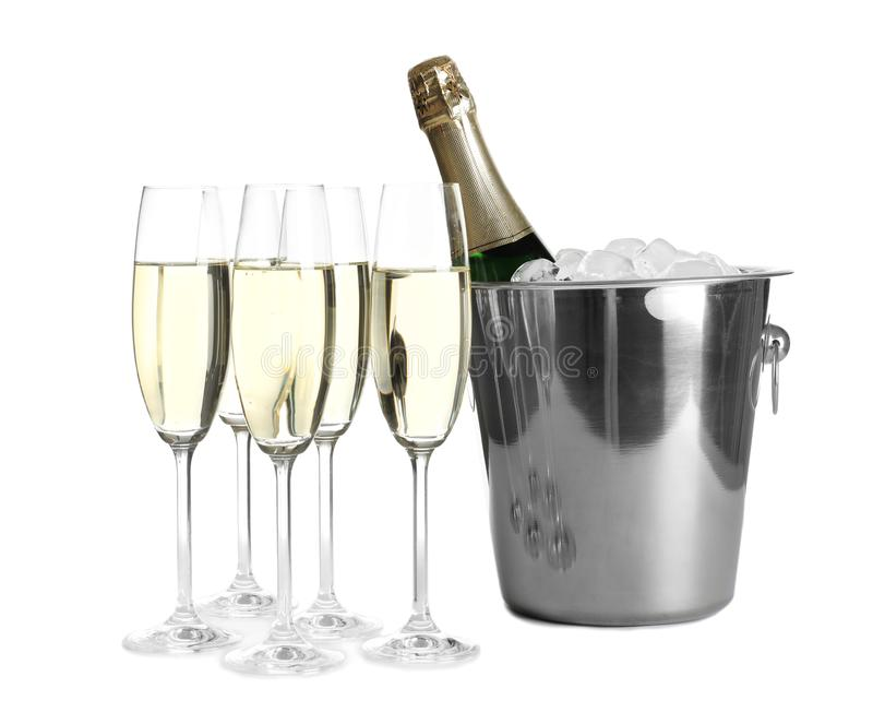 Glasses with champagne and bottle in bucket. On white background stock images