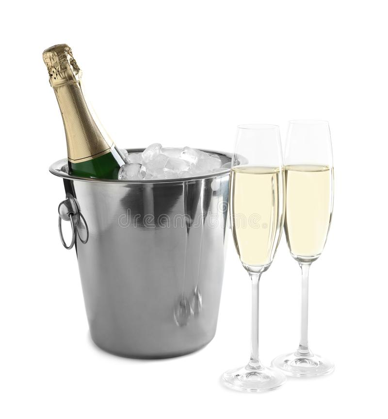 Glasses with champagne and bottle in bucket. On white background royalty free stock images