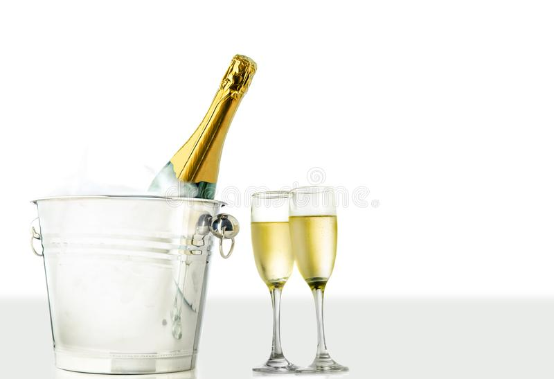 Glasses and champagne bottle in ice bucket stock images