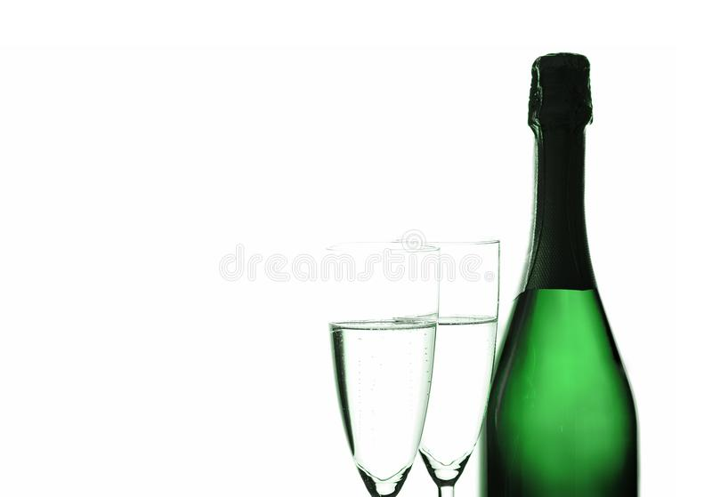 Glasses with champagne. Champagne bottle and champagne glasses, New Year background stock photography