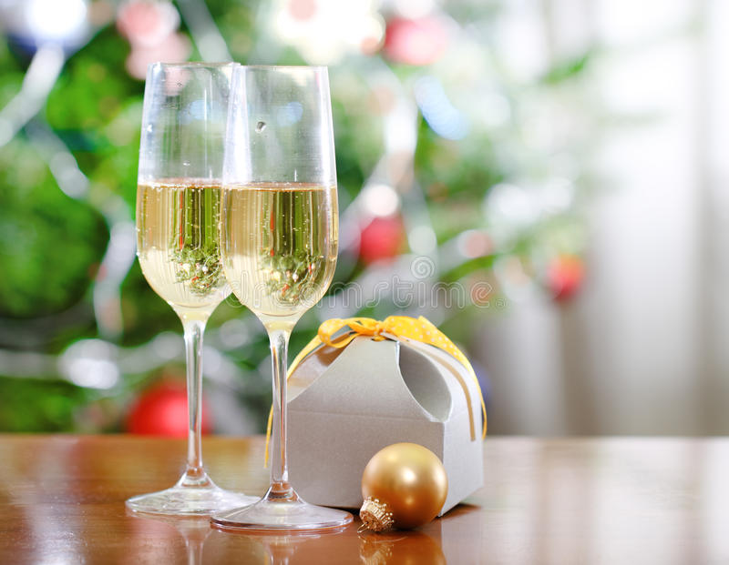 Download Glasses Of Champagne And Christmas Present Stock Image - Image: 26879737