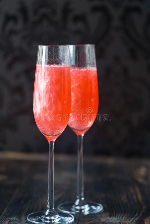 Glasses of champagne cocktail stock photos