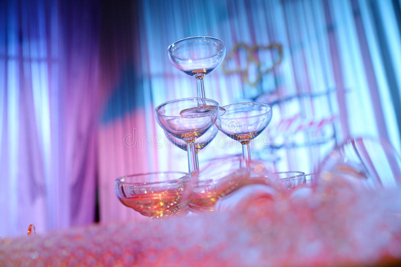 Glasses champagne. Row of glasses champagne on the table stock photography