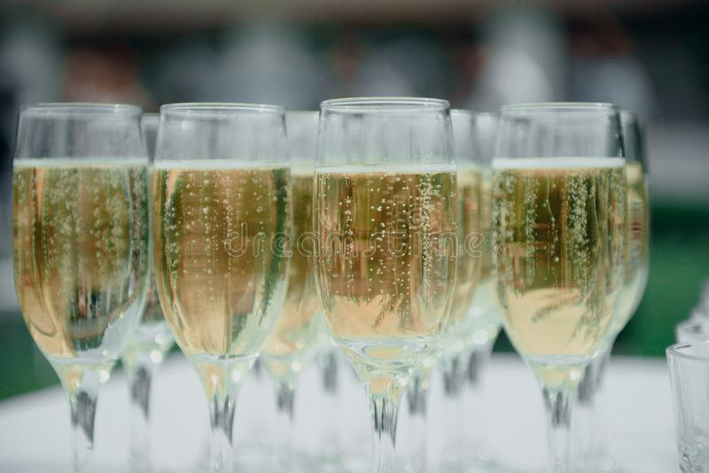 Glasses of champagne are on the table at the reception. Full glasses of champagne on the table, alcohol, dining, wineglass, wedding, event, drink, celebration royalty free stock image