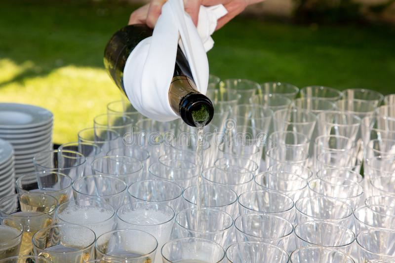 Glasses with champagne at a wedding party outdoor. Some Glasses with champagne at a wedding party outdoor royalty free stock photos
