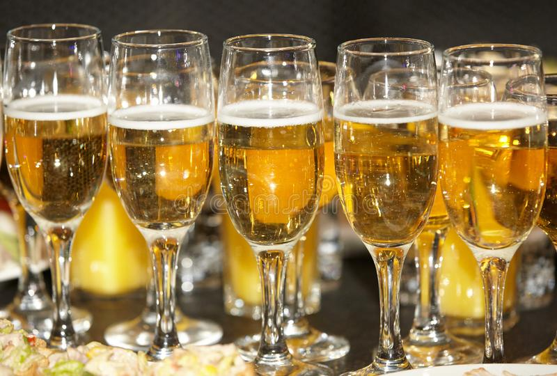 Glasses with champagne or wine of gold color stock photo