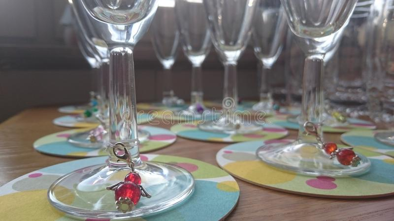 Glasses with Charms. Glasses with Angel Charms royalty free stock photo