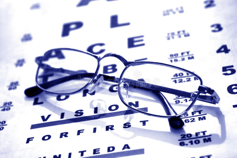 Glasses on chart stock photography