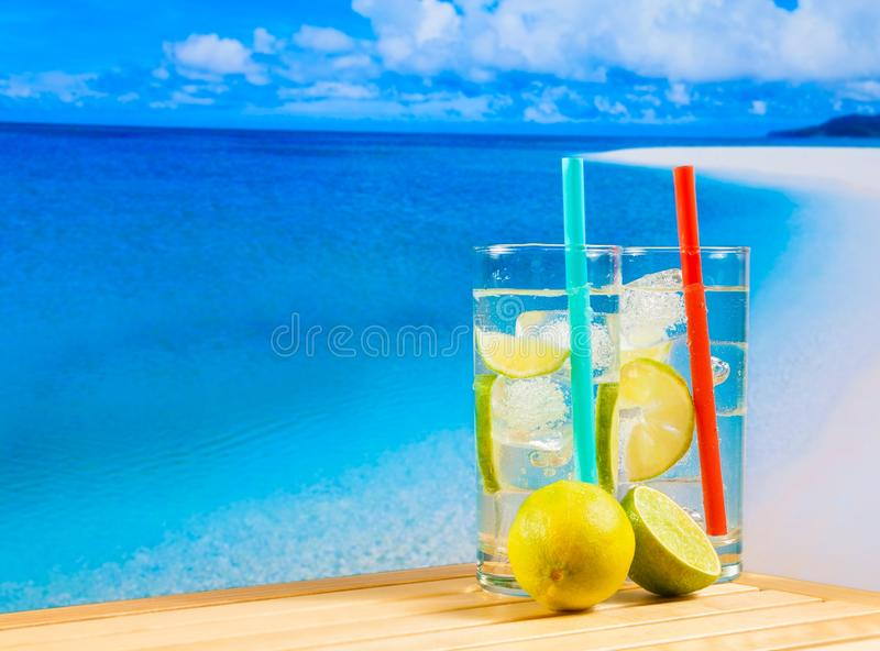 Download Glasses Of Cocktail With Lime Slice On Blur Beach Stock Photo - Image: 42330622