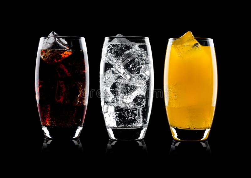 Glasses of cola and orange soda drink and lemonade royalty free stock photo